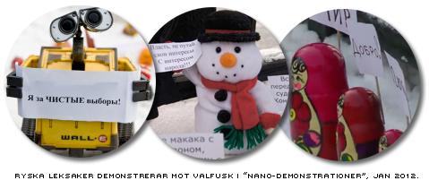 En WallE-robot, en snögubbedocka och ryska Matrjuska-dockor bär små plakat mot ryskt valfusk i en så  kallad nano-demonstrationer