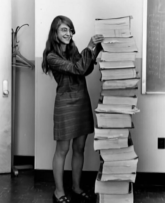 Margaret Hamilton, lead software engineer with her source code for the moon-landing Apollo spacecraft