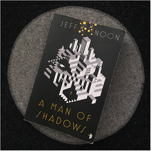a man of shadows av Jeff Noon - omslag